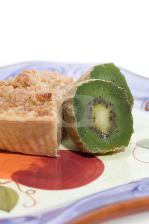 Apple pie slice with kiwi stock photo, A slice of apple pie with slided kiwi, on a plate, isolated on white. by Kevin Woodrow