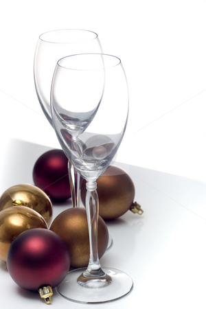 Christmas ornament series stock photo, Champagne glasses surrounded by christmas ornaments, isolated on white. by Kevin Woodrow