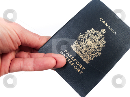 Holding a passport stock photo, A hand holding a Canadian passport, isolated on white. by Kevin Woodrow