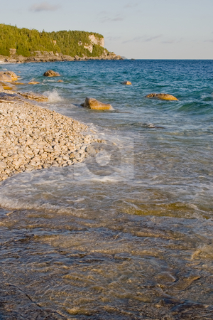 Follow the shoreline stock photo, The shoreline, as it flows towards a cliff in the distance.  Georgian Bay, Ontario by Kevin Woodrow