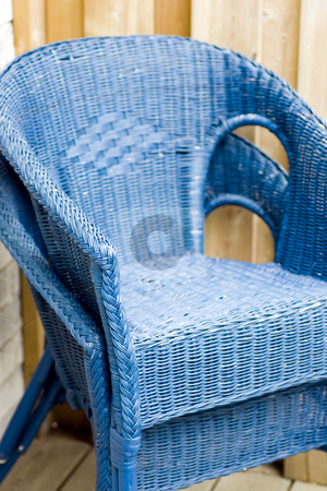 Rattan Chairs, stacked stock photo, Two blue rattan outdoor deck chairs, stacked. by Kevin Woodrow