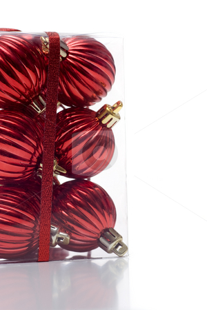 Bunch of boxed ornaments stock photo, A package of christmas ornaments, packaged in a clear plastic box, wrapped in ribbon, and isolated on white. by Kevin Woodrow