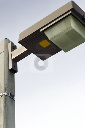 Isolated Lamp Post Lighting stock photo, An isolated shot of the top of a lamp post, focus on the lamp casing, with a clear blue sky background by Kevin Woodrow