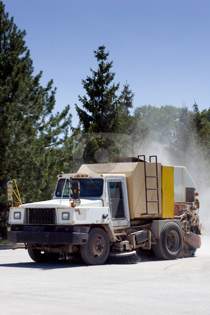 Street sweeper with dust trail stock photo, A street sweeper truck with a dust cloud behind. by Kevin Woodrow