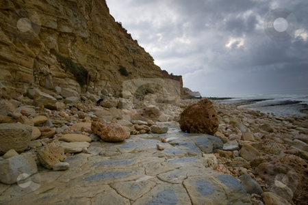 Falling rock, Horizontal stock photo, Falling rock from the cliffs, along the beaches in Lagos, Portugal. by Kevin Woodrow