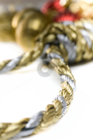 Christmas Pressures stock photo, Noose made out of christmas rope, with baubles in the background, isolated on white. by Kevin Woodrow