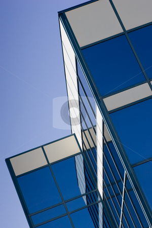 Glass office building stock photo, Glass Office Building and reflection, with a blue sky background. by Kevin Woodrow