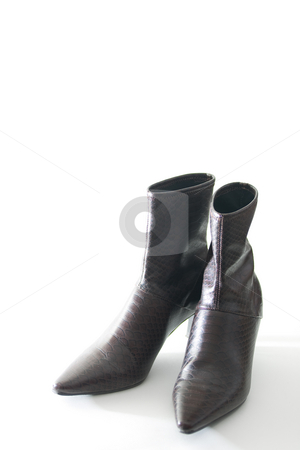 High heel boots stock photo, Stylish women's high-heel boots, isolated on white. by Kevin Woodrow