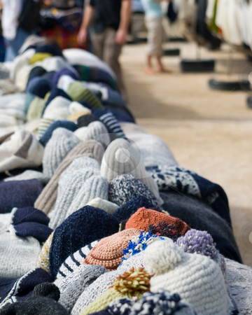 Hat Lineup stock photo, A lineup of hats for sale at a local market.  Cape Saint Vincent, Sagres, Portugal by Kevin Woodrow