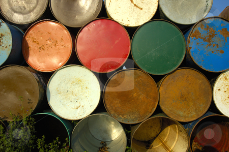 Barrels on end stock photo, A stack of grungy old oil drums at a music festival, ready to be set out as rubbish bins. by Alistair Scott