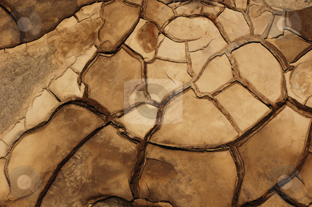 Cracked mud stock photo, Close-up abstract of cracked mud on a tidal river shore. Suitable as abstract, patterned background. by Alistair Scott