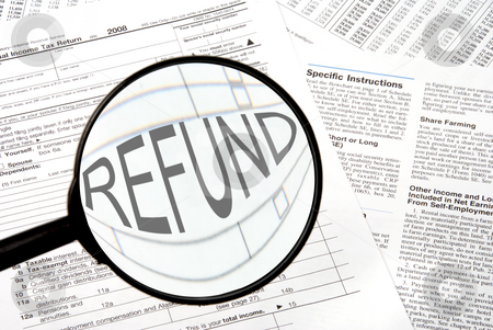 Tax Forms stock photo, Federal tax forms under a magnifying glass. by Robert Byron