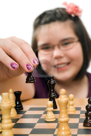 Chess Tournament stock photo, Closeup view of a young girl playing in a chess tournament by Richard Nelson