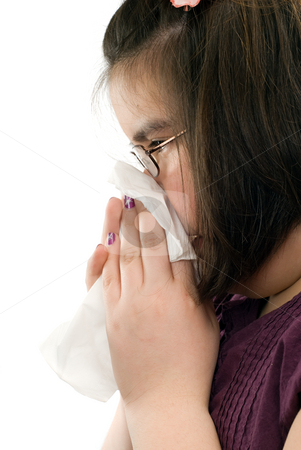 Runny Nose stock photo, Closeup view of a young girl blowing her nose, shot on a profile view, isolated against a white background by Richard Nelson