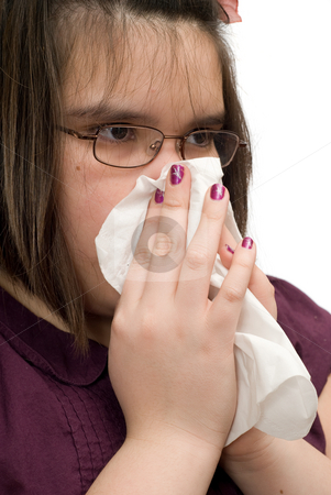 Girl Wiping Nose stock photo, Closeup view of a young girl wiping her runny nose by Richard Nelson