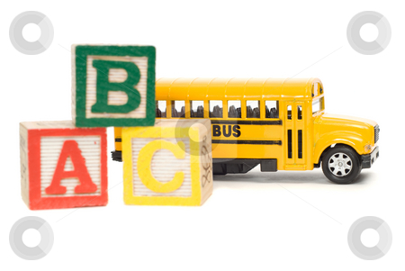Elementary School Concept stock photo, Concept image of elementary school using a toy school bus and baby letter blocks by Richard Nelson