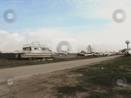 Boats along road stock photo, Boats are scattered along a road after Hurricane Ike destroyed a marina at Pleasure Island, Port Arthur, Texas by Robert Brown
