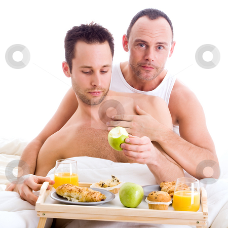 Enjoying the apple stock photo, A Happy homo couple and their breakfast on a tray in bed by Frenk and Danielle Kaufmann