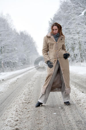Winter landscape woman standing on a snowy road stock photo, Woman standing on a snowy road by Frenk and Danielle Kaufmann
