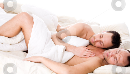 Sleeping together stock photo, Happy homo couple in a white bed taking care of his boyfriend by Frenk and Danielle Kaufmann