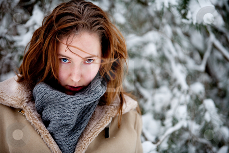 Two colored eyes in winter scene stock photo, Woman with two different colored eyes standing in a winter landscape by Frenk and Danielle Kaufmann