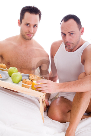Happy homo breakfast stock photo, A Happy homo couple and their breakfast on a tray in bed by Frenk and Danielle Kaufmann