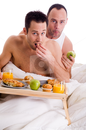 Home couple eating healthy stock photo, A Happy homo couple and their breakfast on a tray in bed by Frenk and Danielle Kaufmann