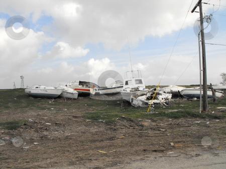 Wrecked boats stock photo, Boats left on land after hurricane Ike hit Pleasure Island, Port Arthur, Texas by Robert Brown