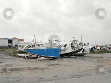 Damaged boats stock photo, Boats A left destroyed after Hurrican Ike hit Pleasure Island,Port Arthur, Texas by Robert Brown