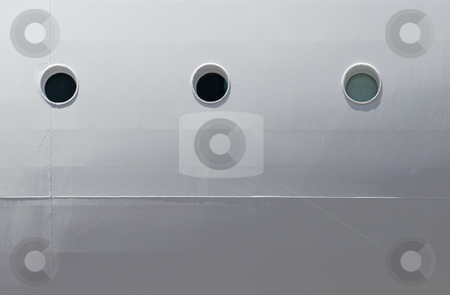 Portholes stock photo, A row of three portholes on the site of a cruise ship by Stephen Gibson