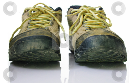 Outdoor shoes stock photo, frontal shot of dirty outdoor shoes. Isolated on white by Martin Darley
