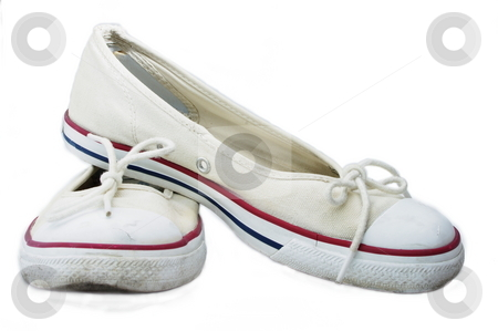 Sandshoes stock photo, Old white canvas sandshoes with red and blue stripes. Isolated on white by Martin Darley
