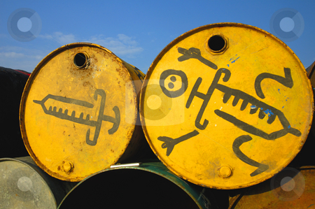 Grungy drums stock photo, Symbols of a syringes, painted on the ends of two old oil drums that have been stacked to be used as a waste bins at a music festival. by Alistair Scott
