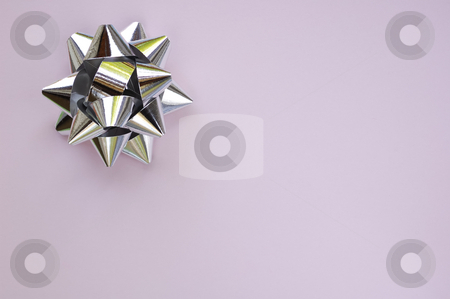 Star on lilac stock photo, A decorative star, made from silver ribbon, on a plain lilac background with space for text (copy). by Alistair Scott