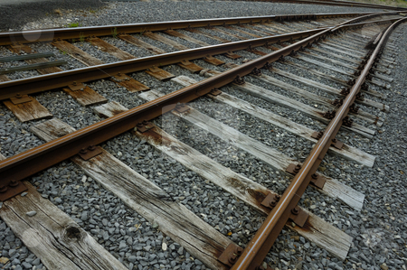 Railway lines stock photo, Rusty railway tracks stretch away into the distance, converging. by Alistair Scott