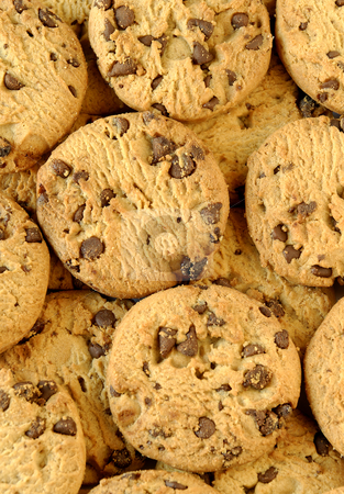 Cookie background stock photo, A background of delicious chocolate chip cookies by Paul Turner