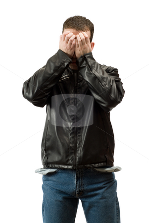 Broke Unemployed Man stock photo, A broke unemployed man is covering his face in embarrassment, isolated against a white background by Richard Nelson