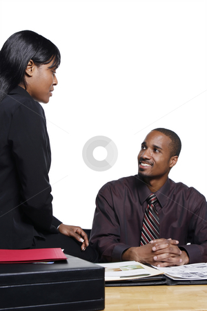 Business Colleagues Smiling stock photo, Male and female business colleagues smiling as they chat together. Vertical shot isolated against a white background. by Orange Line Media