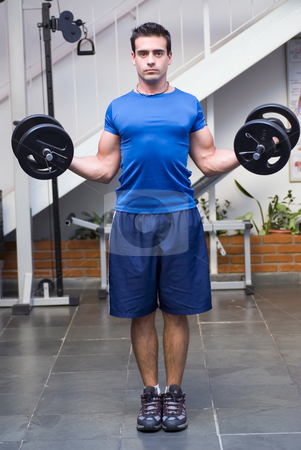 Curls with Dumbbell Weights stock photo, Male athelete / weightlifter, looking straight into camera, doing curls with dumbbell weights in his hands. by Orange Line Media