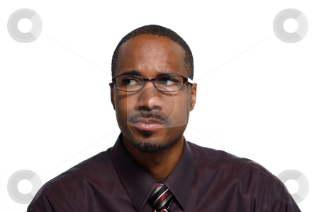 Man Looking Puzzled - Horizontal stock photo, Attractive young man in shirt and tie looking puzzled. Isolated against a white background by Orange Line Media