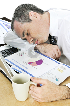 Businessman asleep at his desk on white background stock photo, Tired businessman asleep at his desk isolated on white background by Elena Elisseeva