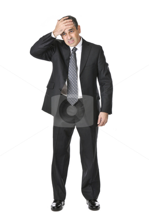 Businessman on white background stock photo, Upset businessman in a suit isolated on white background by Elena Elisseeva