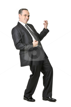 Businessman on white background stock photo, Happy businessman in a suit playing an air guitar isolated on white background by Elena Elisseeva