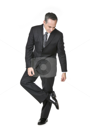 Businessman on white background stock photo, Businessman in a suit looking at his shoe isolated on white background by Elena Elisseeva