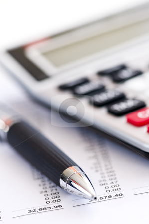 Tax calculator and pen stock photo, Calculating numbers for income tax return with pen and calculator by Elena Elisseeva