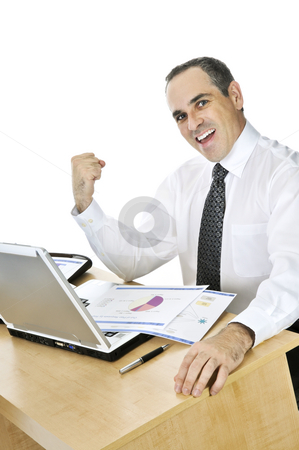 Businessman at his desk on white background stock photo, Happy smiling businessman sitting at his desk isolated on white background by Elena Elisseeva