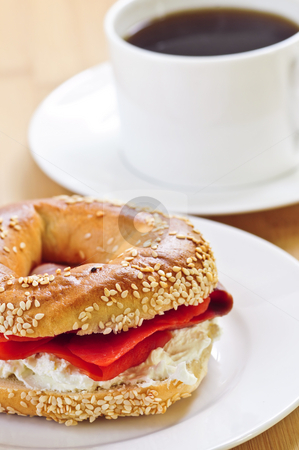 Smoked salmon bagel and coffee stock photo, Light meal of smoked salmon bagel and coffee by Elena Elisseeva