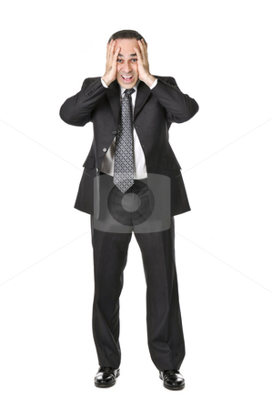 Businessman on white background stock photo, Businessman in a suit being upset isolated on white background by Elena Elisseeva