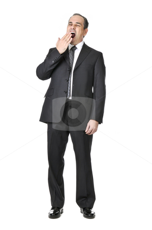 Businessman on white background stock photo, Bored yawning businessman in a suit isolated on white background by Elena Elisseeva