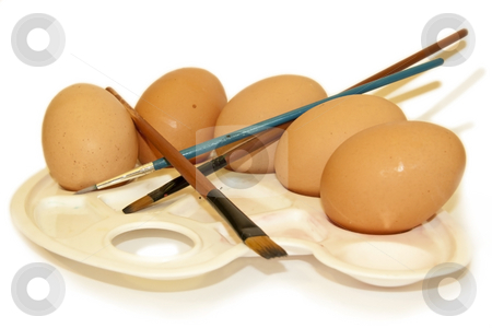Eggs on a palette with brushes stock photo, Eggs displayed on a palette with paint brushes, isolated on a white background by Chris Alleaume